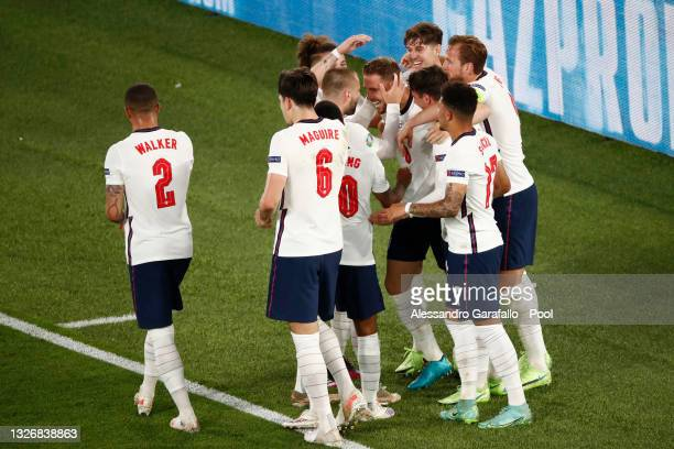 Jordan Henderson of England celebrates with Luke Shaw, John Stones, Harry Kane and team mates after scoring their side's fourth goal during the UEFA...