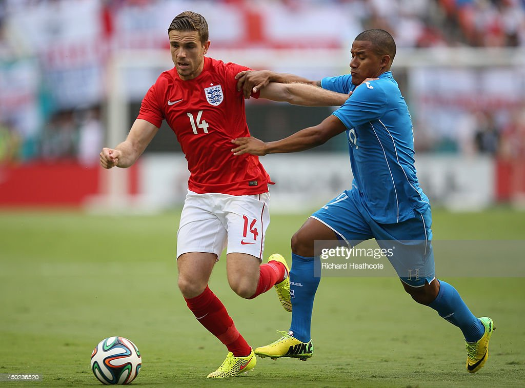Jordan Henderson of England handles the ball against Luis Garrido of Honduras in the first half during the International Friendly match between England and Honduras at Sun Life Stadium on June 7, 2014 in Miami Gardens, Florida.