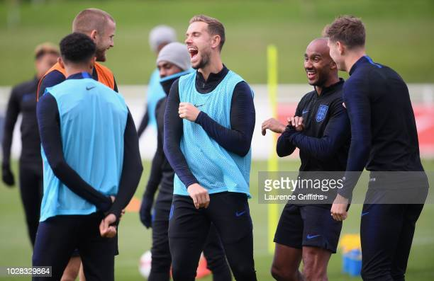 Jordan Henderson of England laughs with team mates during an England training session at St Georges Park on September 7 2018 in BurtonuponTrent...