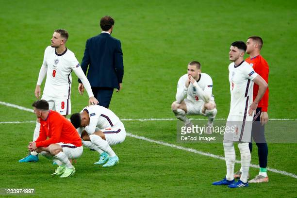 Jordan Henderson of England, Luke Shaw of England and Declan Rice of England look dejected after the UEFA Euro 2020 Championship Final between Italy...