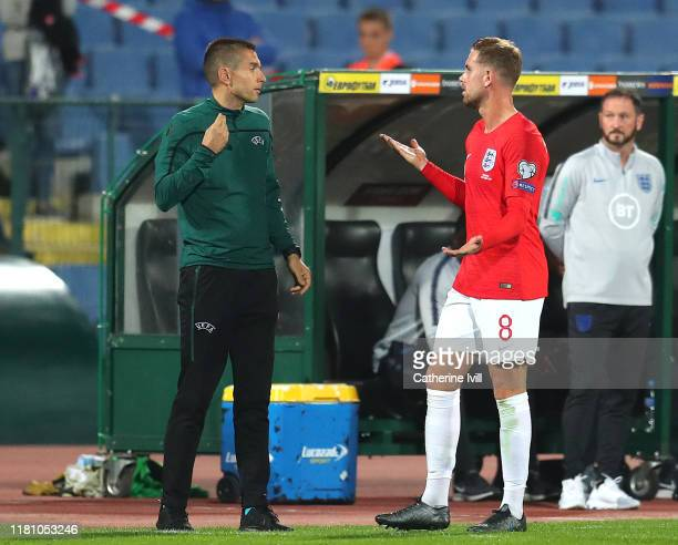 Jordan Henderson of England questions an official during the UEFA Euro 2020 qualifier between Bulgaria and England on October 14 2019 in Sofia...