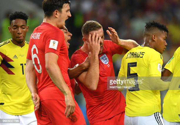 Jordan Henderson of England reacts after Wilmar Barrios of Colombia headbutts him during the 2018 FIFA World Cup Russia Round of 16 match between...