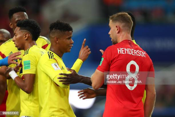 Jordan Henderson of England reacts following a clash with Wilmar Barrios of Colombia during the 2018 FIFA World Cup Russia Round of 16 match between...