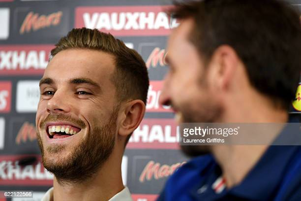 Jordan Henderson of England smiles next to Gareth Southgate Interim England manager during a press conference ahead of the FIFA 2018 World Cup...