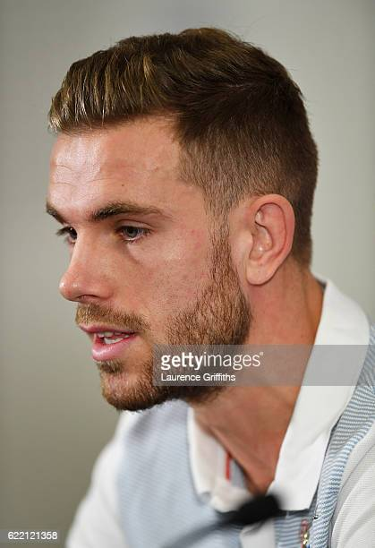 Jordan Henderson of England speaks during a press conference ahead of the FIFA 2018 World Cup qualifying group F match against Scotland at St...