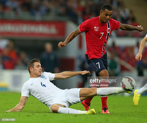 Jordan Henderson of England tackles Joshua King of Norway