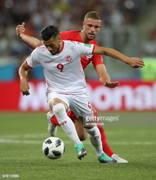 Jordan Henderson of England vies with Anice Badri of Tunisia during the 2018 FIFA World Cup Russia group G match between Tunisia and England at...