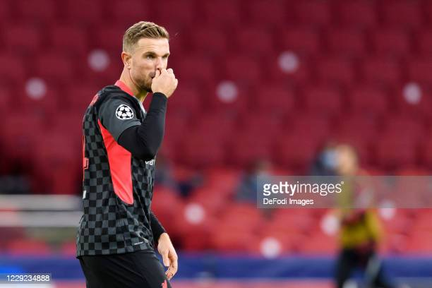 Jordan Henderson of FC Liverpool looks on during the UEFA Champions League Group D stage match between Ajax Amsterdam and Liverpool FC at Johan...
