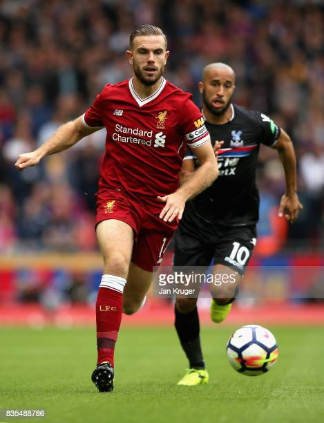 Jordan Henderson of Liverpool and Andros Townsend of Crystal Palace battle for possession during the Premier League match between Liverpool and...