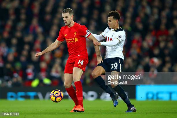 Jordan Henderson of Liverpool and Dele Alli of Tottenham Hotspur compete for the ball during the Premier League match between Liverpool and Tottenham...