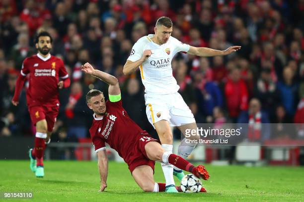 Jordan Henderson of Liverpool and Edin Dzeko of AS Roma in action during the UEFA Champions League Semi Final First Leg match between Liverpool and...