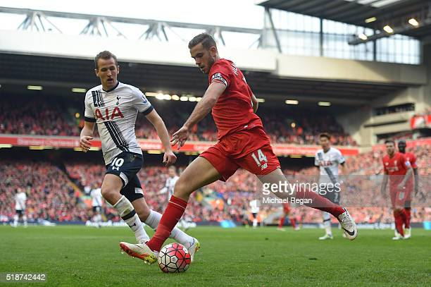 Jordan Henderson of Liverpool and Harry Kane of Tottenham Hotspur compete for the ball during the Barclays Premier League match between Liverpool and...