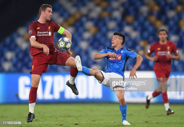 Jordan Henderson of Liverpool and Hirving Lozano of Napoli battle for the ball during the UEFA Champions League group E match between SSC Napoli and...