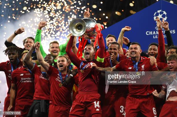 Jordan Henderson of Liverpool and his teammates celebrate with the UEFA Champions League Trophy following their team's victory in the UEFA Champions...
