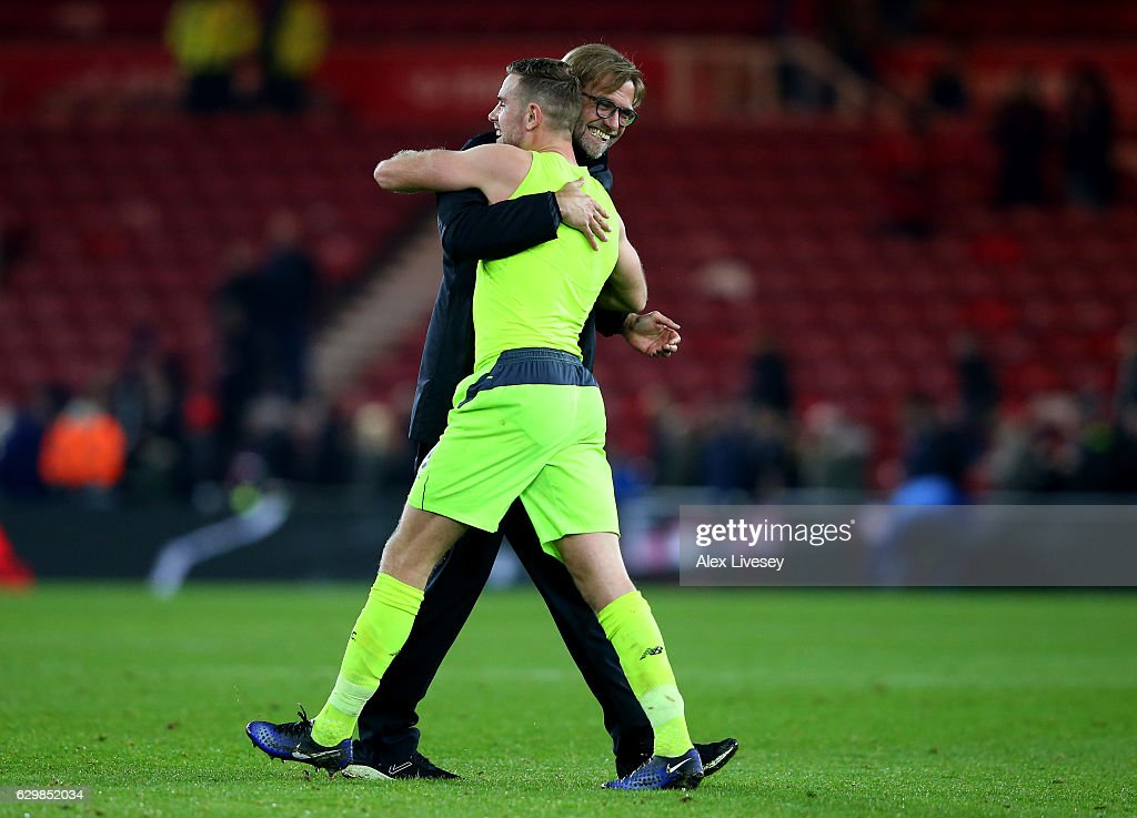 Jordan Henderson of Liverpool (L) and Jurgen Klopp, Manager of Liverpool (R) embrace after the final whistle during the Premier League match between Middlesbrough and Liverpool at Riverside Stadium on December 14, 2016 in Middlesbrough, England.
