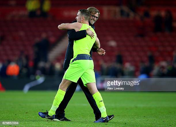 Jordan Henderson of Liverpool and Jurgen Klopp Manager of Liverpool embrace after the final whistle during the Premier League match between...