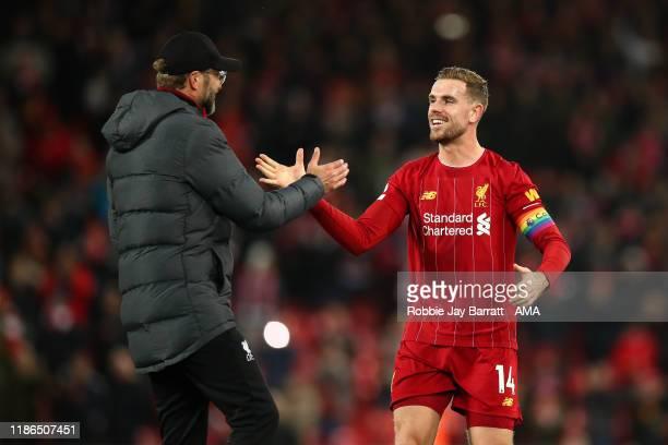 Jordan Henderson of Liverpool and Jurgen Klopp the head coach / manager of Liverpool celebrate winning the Premier League match between Liverpool FC...