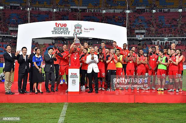 Jordan Henderson of Liverpool and liverpool team celebrate with the trophy during the international friendly match between Thai Premier League All...