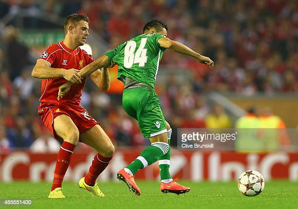 Jordan Henderson of Liverpool and Marcelinho of PFC Ludogorets Razgrad battle for the ball during the UEFA Champions League Group B match between...