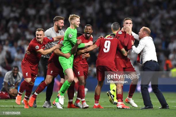 Jordan Henderson of Liverpool and teammates celebrate at full-time after winning the UEFA Champions League Final between Tottenham Hotspur and...