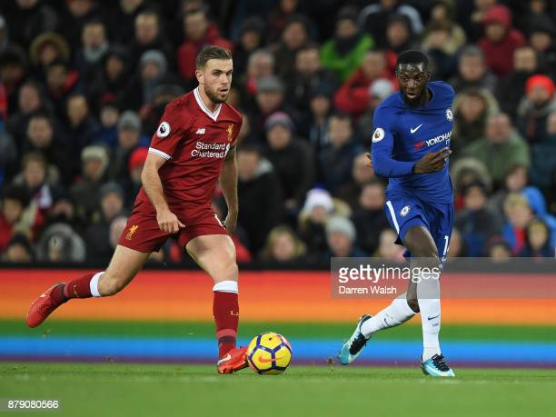 Jordan Henderson of Liverpool and Tiemoue Bakayoko of Chelsea in action during the Premier League match between Liverpool and Chelsea at Anfield on...
