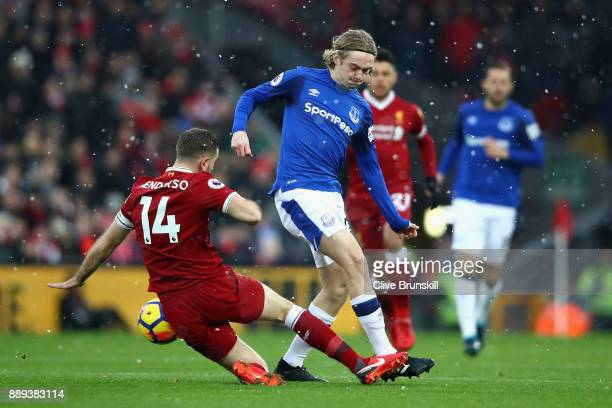 Jordan Henderson of Liverpool and Tom Davies of Everton during the Premier League match between Liverpool and Everton at Anfield on December 10 2017...