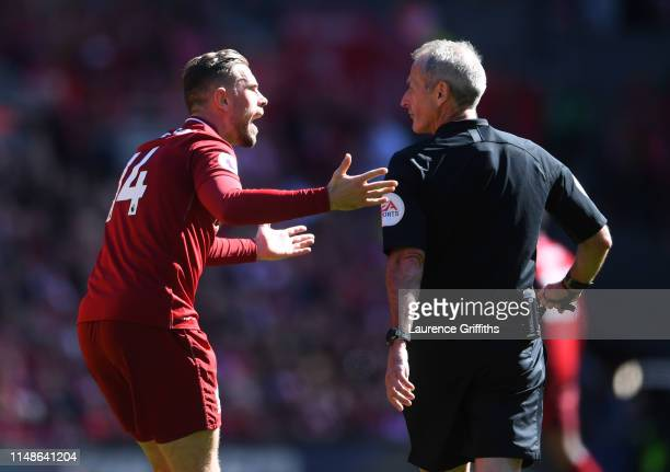 Jordan Henderson of Liverpool appeals to referee Martin Atkinson during the Premier League match between Liverpool FC and Wolverhampton Wanderers at...