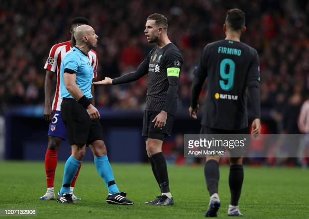 Jordan Henderson of Liverpool appeals to referee Szymon Marciniak during the UEFA Champions League round of 16 first leg match between Atletico...