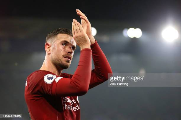 Jordan Henderson of Liverpool applauds fans as he leaves the pitch following an injury during the Premier League match between Leicester City and...
