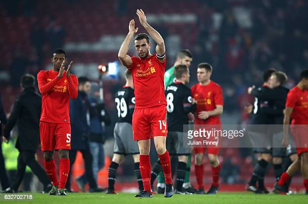 Jordan Henderson of Liverpool applauds supporters following defeat in the EFL Cup SemiFinal Second Leg match between Liverpool and Southampton at...
