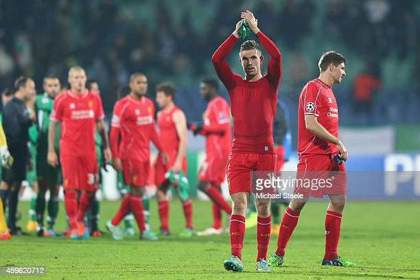 Jordan Henderson of Liverpool applauds the travelling fans after his sides 22 draw during the UEFA Champions League Group B match between Ludogorets...