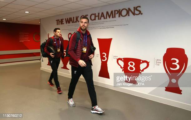 Jordan Henderson of Liverpool arrives with team mates during the UEFA Champions League Round of 16 First Leg match between Liverpool and FC Bayern...