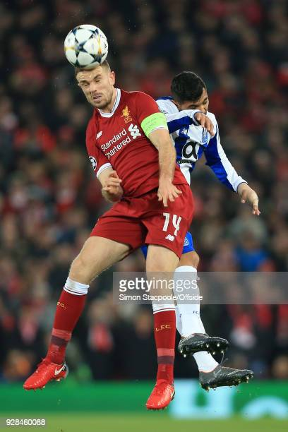 Jordan Henderson of Liverpool battles with Jesus Manuel Corona of Porto during the UEFA Champions League Round of 16 Second Leg match between...