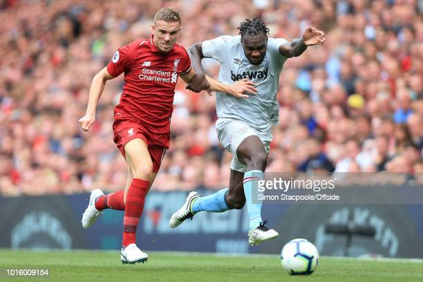 Jordan Henderson of Liverpool battles with Michail Antonio of West Ham during the Premier League match between Liverpool and West Ham United at...
