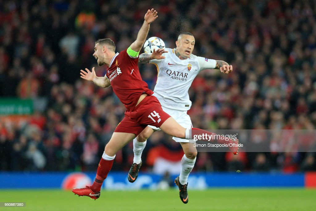 Jordan Henderson of Liverpool battles with Radja Nainggolan of Roma during the UEFA Champions League Semi Final First Leg match between Liverpool and A.S. Roma at Anfield on April 24, 2018 in Liverpool, United Kingdom.