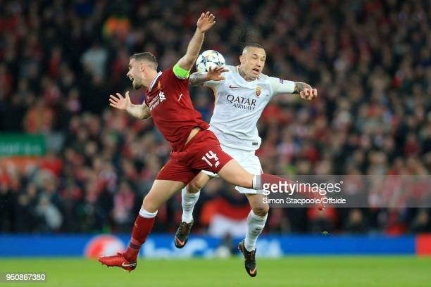 Jordan Henderson of Liverpool battles with Radja Nainggolan of Roma during the UEFA Champions League Semi Final First Leg match between Liverpool and...