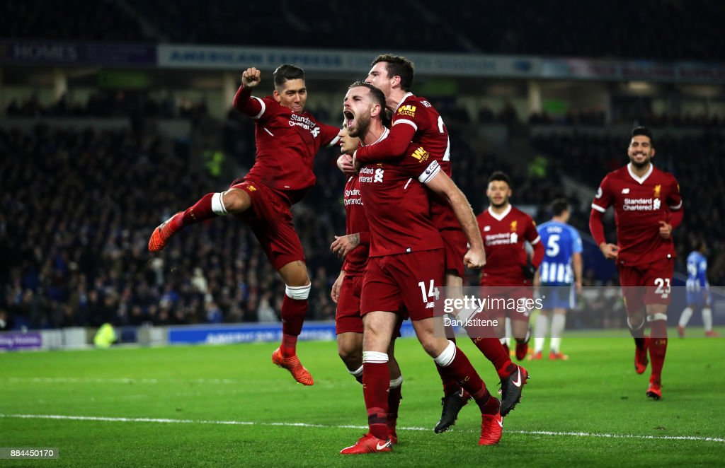 Jordan Henderson of Liverpool celebrates after his team mate Philippe Coutinho of Liverpool (obscre) scored his sides fourth goal during the Premier League match between Brighton and Hove Albion and Liverpool at Amex Stadium on December 2, 2017 in Brighton, England.
