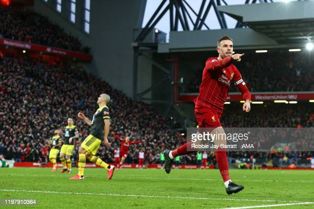 Jordan Henderson of Liverpool celebrates after scoring a goal to make it 2-0 during the Premier League match between Liverpool FC and Southampton FC...