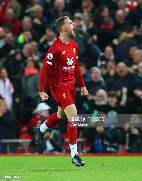 Jordan Henderson of Liverpool celebrates after scoring his team's first goal during the Premier League match between Liverpool FC and Tottenham...