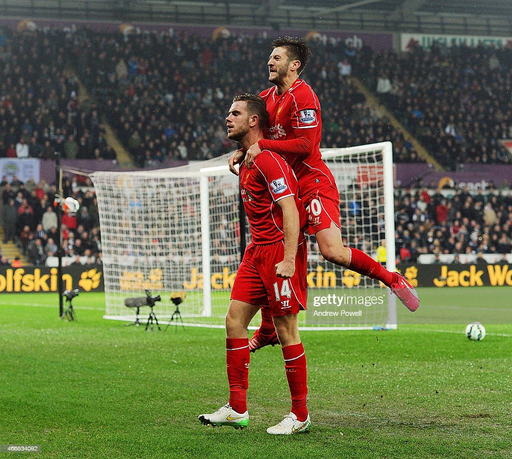 Jordan Henderson of Liverpool celebrates after scoring the opening goal during the Barclays Premier League match between Swansea City and Liverpool at Liberty Stadium on March 16, 2015 in Swansea, Wales.