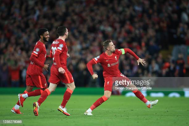 Jordan Henderson of Liverpool celebrates after scoring the third goal for his team during the UEFA Champions League group B match between Liverpool...