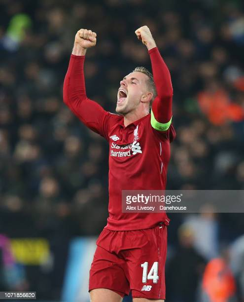 Jordan Henderson of Liverpool celebrates after the UEFA Champions League Group C match between Liverpool and SSC Napoli at Anfield on December 11...