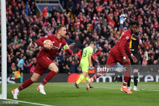 Jordan Henderson of Liverpool celebrates as Divock Origi scores his team's first goal during the UEFA Champions League Semi Final second leg match...