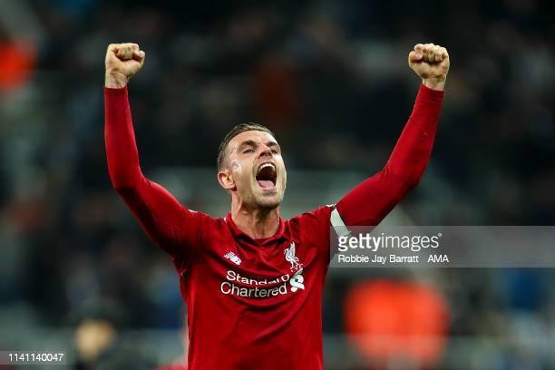 Jordan Henderson of Liverpool celebrates at full time during the Premier League match between Newcastle United and Liverpool FC at St James Park on...
