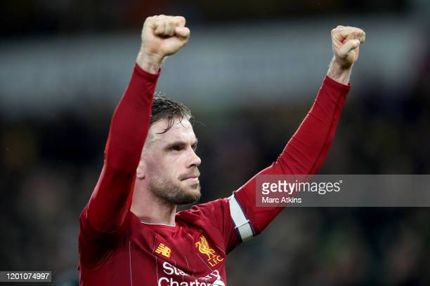 Jordan Henderson of Liverpool celebrates during the Premier League match between Norwich City and Liverpool FC at Carrow Road on February 15 2020 in...