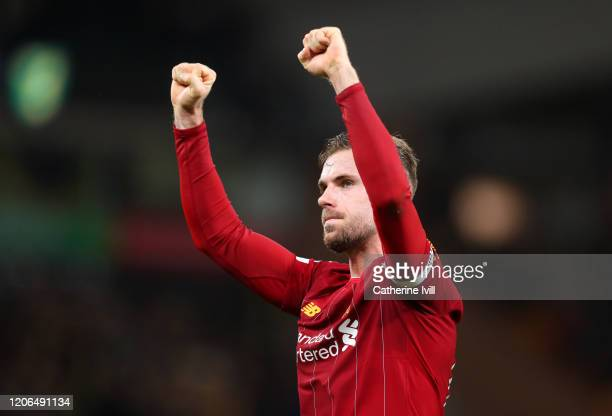 Jordan Henderson of Liverpool celebrates following his sides victory in the Premier League match between Norwich City and Liverpool FC at Carrow Road...