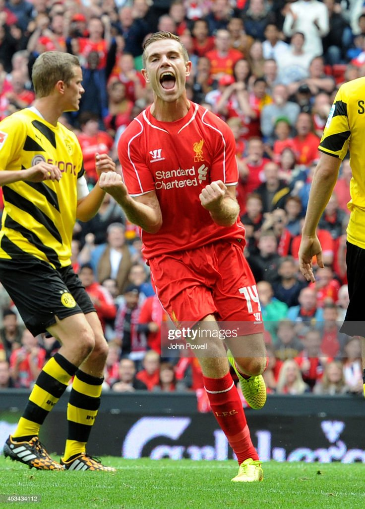 Jordan Henderson of Liverpool celebrates his goal during Pre Season Friendly match between Liverpool and Borussia Dortmund at Anfield on August 10, 2014 in Liverpool, England.