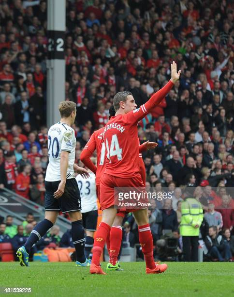 Jordan Henderson of Liverpool celebrates his goal with team mates during the Barclays Premier League match between Liverpool and Tottenham Hotspur at...