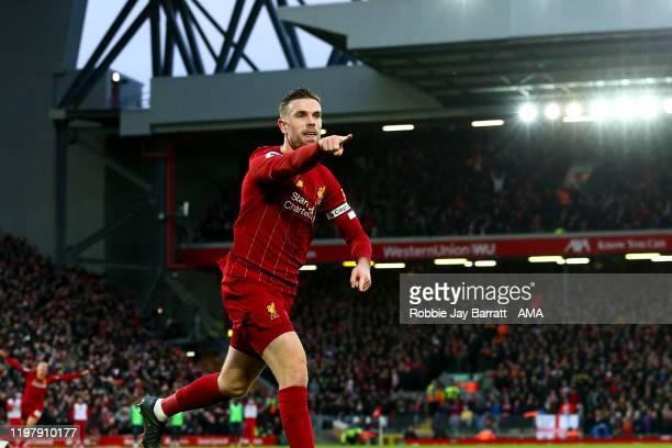 Jordan Henderson of Liverpool Celebrates scoring a goal to make it 2-0 during the Premier League match between Liverpool FC and Southampton FC at...