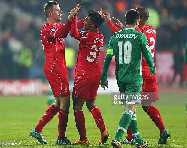 Jordan Henderson of Liverpool celebrates scoring his sides second goal with Raheem Sterling during the UEFA Champions League Group B match between...